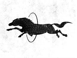 Horse jumping through hoop